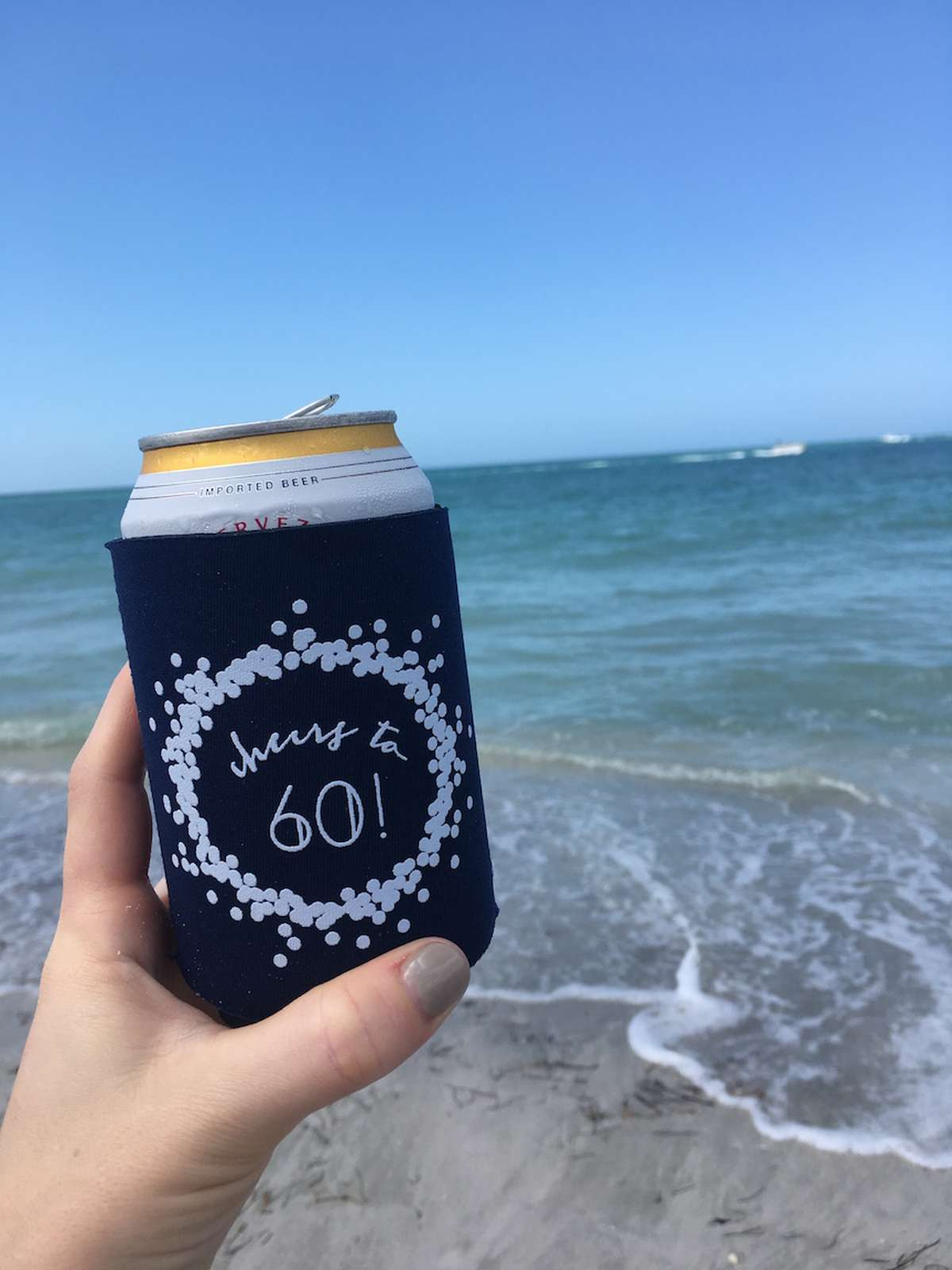 personalized koozie at the beach