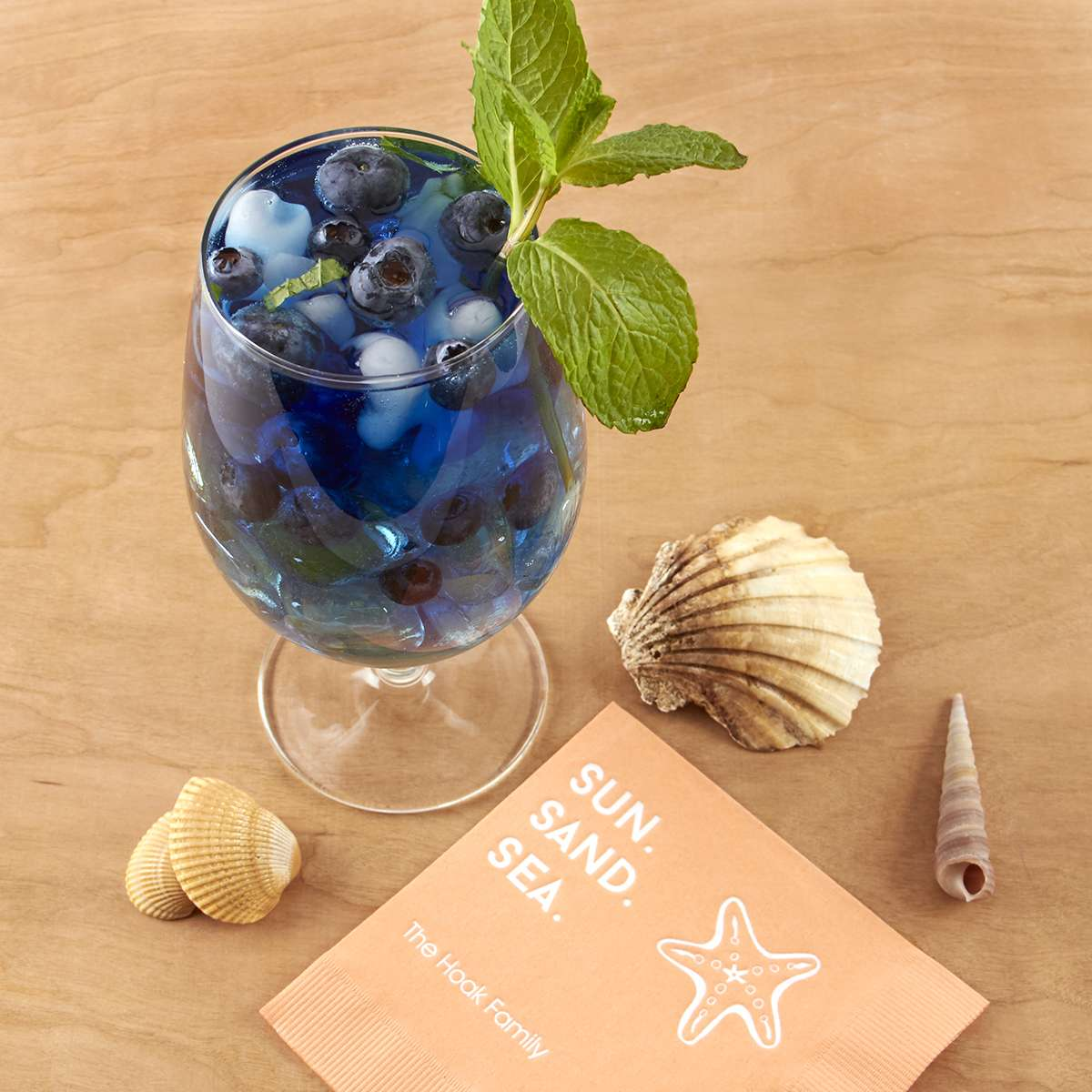 blue beach drink with personalized cocktail napkin