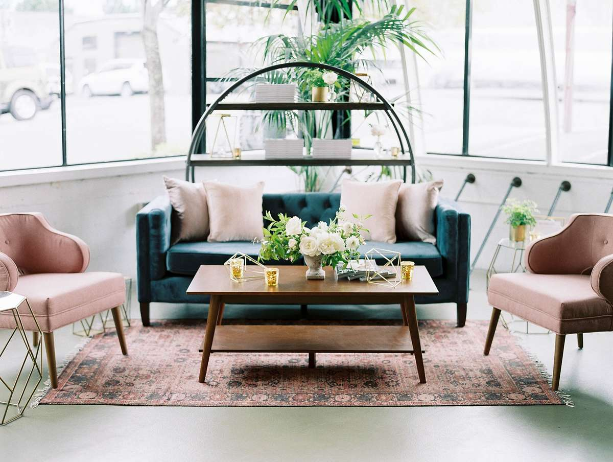 chic mingling corner with navy and blush seating and gold accents