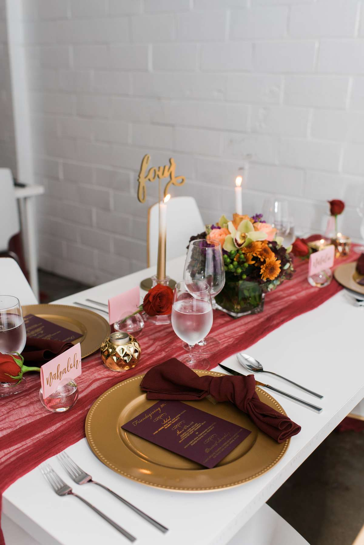 red and maroon table decorations with gold charger