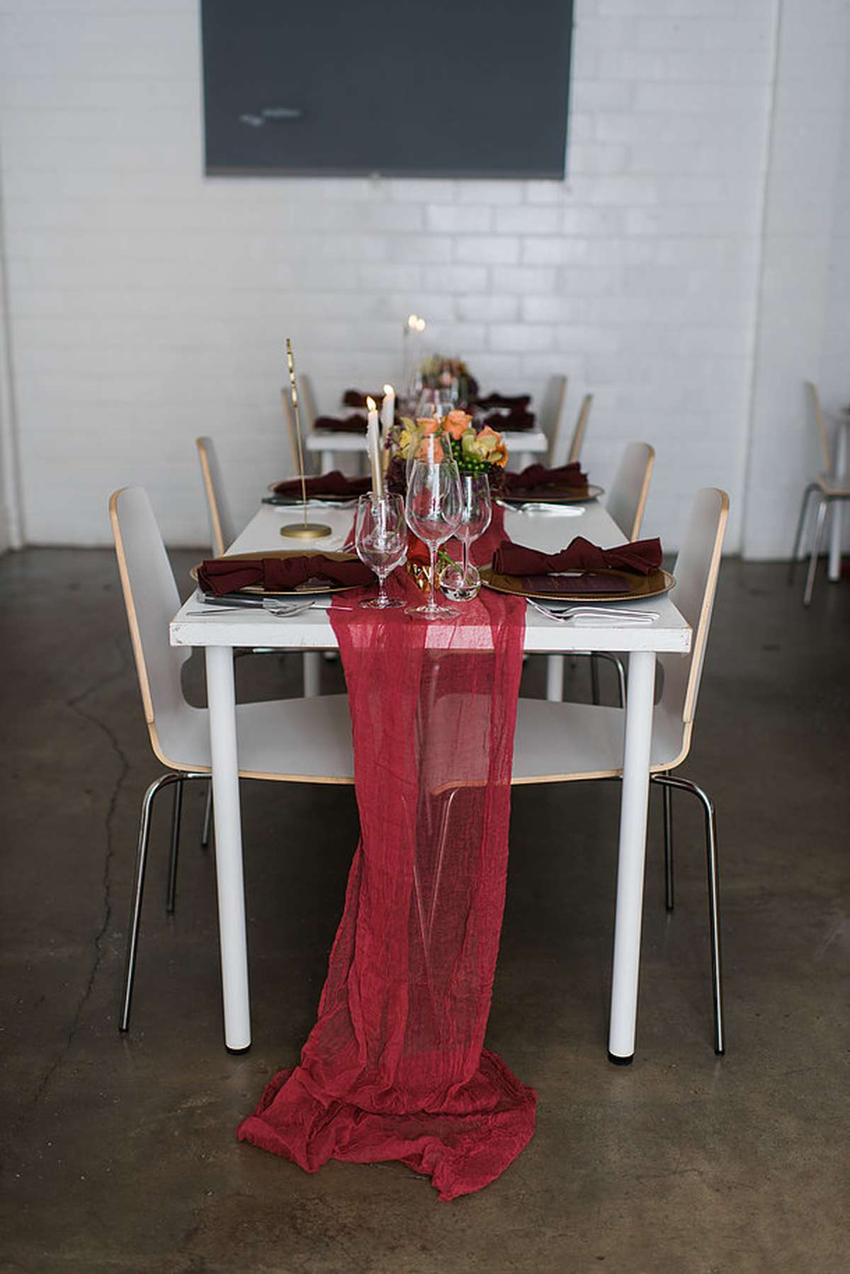 long table runner with red and maroon table decorations