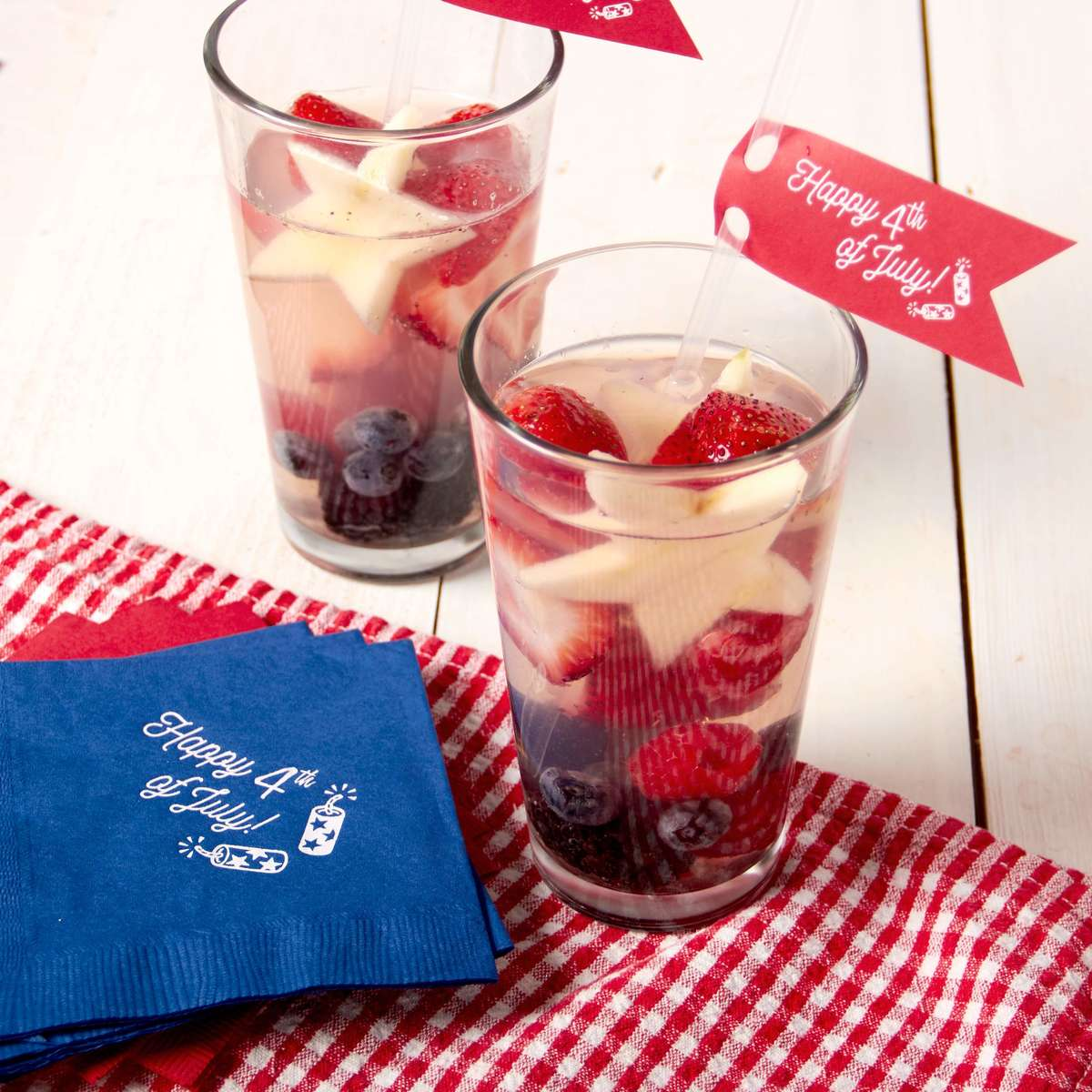 4th of july cocktail with personalized napkins and custom straw tags