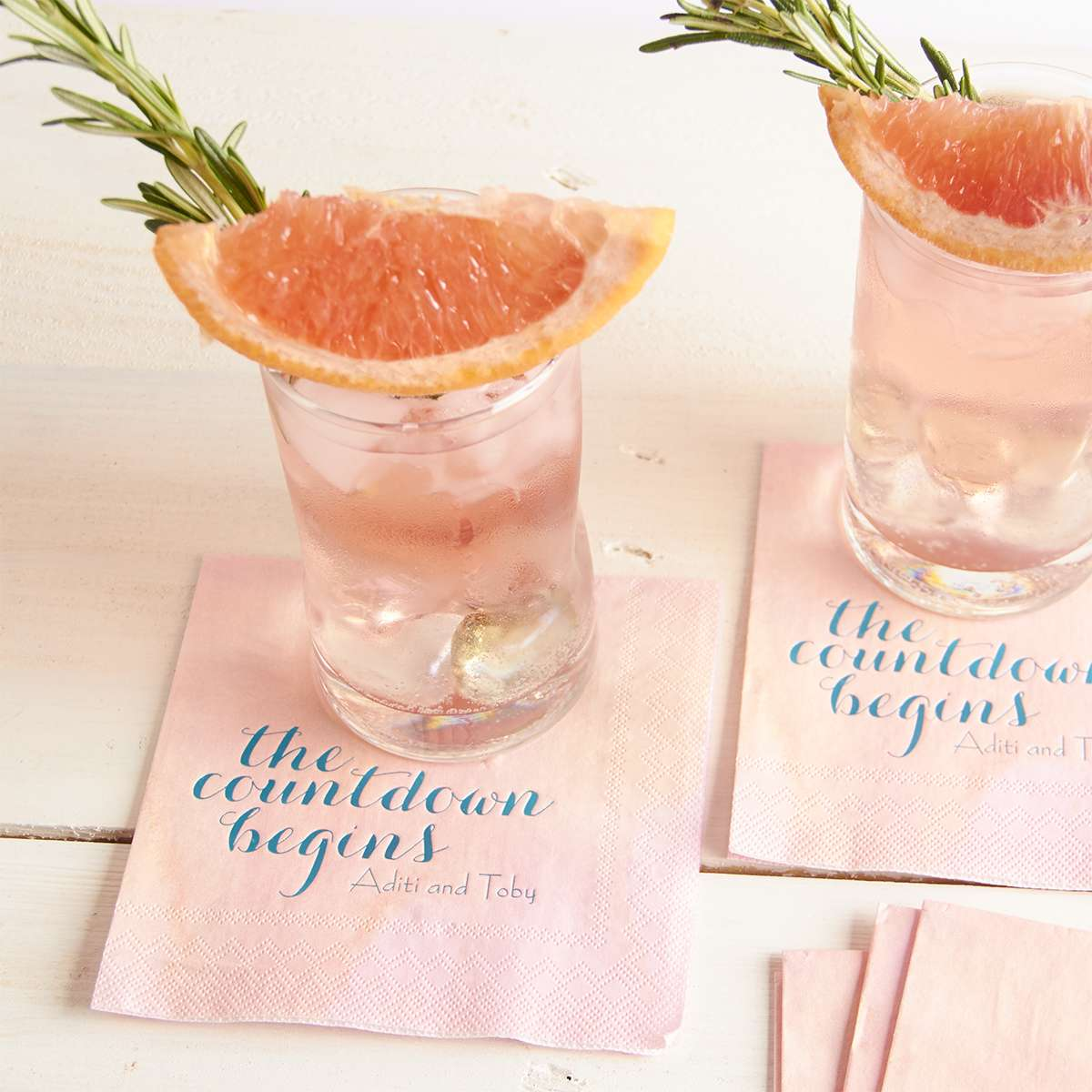 summer grapefruit and gin cocktail on a watercolor personalized cocktail napkin