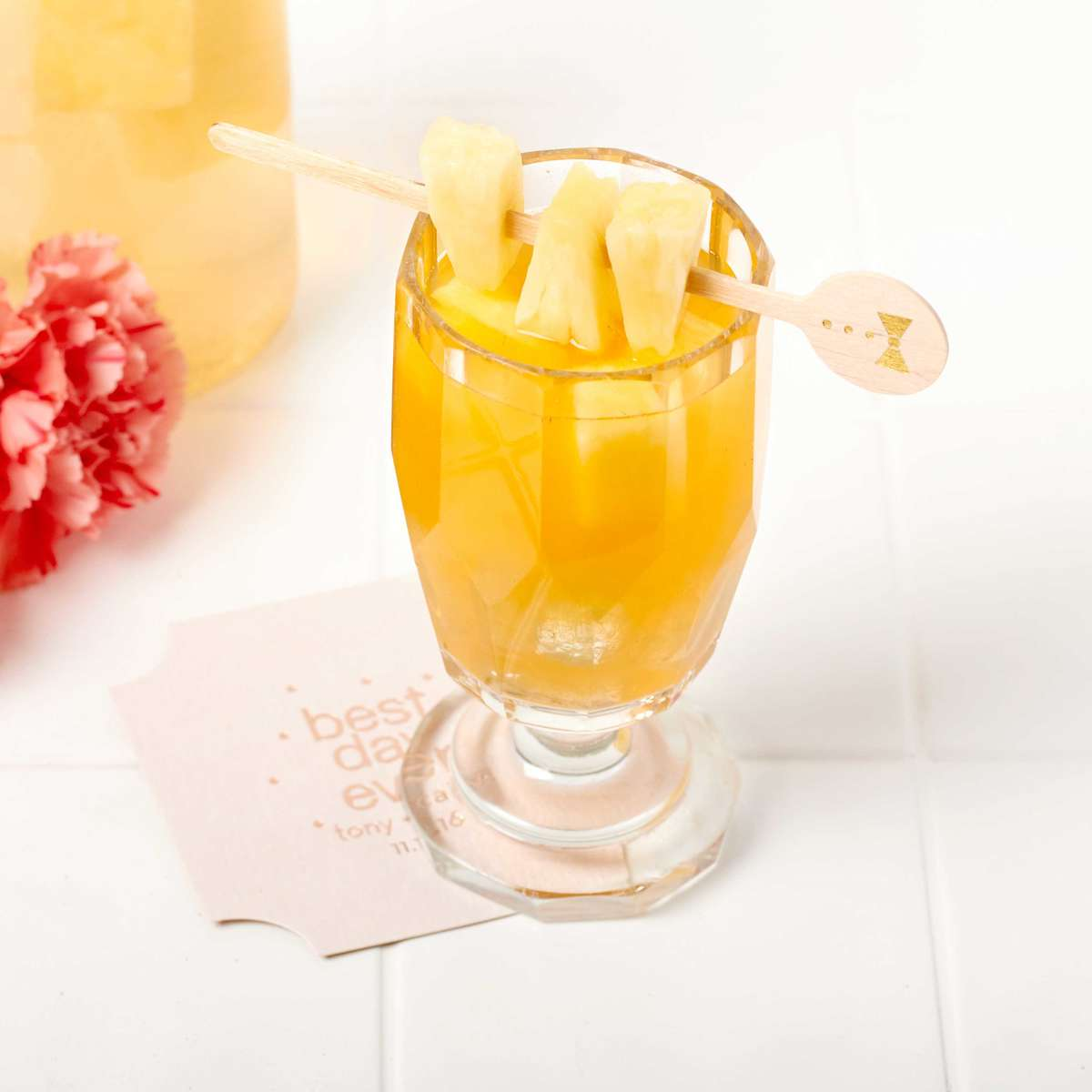 Pineapple Rum Punch cocktail with personalized drink stirrer